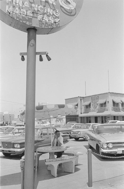 1970 San Diego Calif - man and car lot.jpg