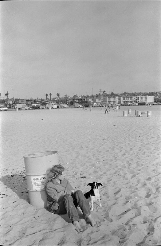 1970 San Diego woman and dog at beach.jpg