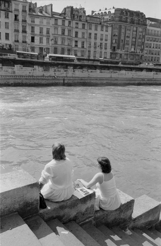 1979_Paris two women sit along river.jpg