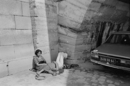1979_Paris couple resting with car.jpg