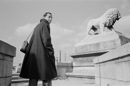 1979_Paris man on steps with lion.jpg