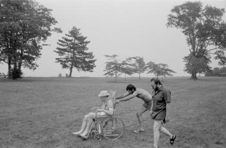 pushing man in wheelchair.jpg